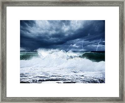 Thunderstorm And Lightning On The Beach Framed Print by Anna Omelchenko