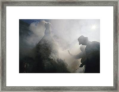 Tibetan Buddhists Pray And Make Framed Print by Justin Guariglia