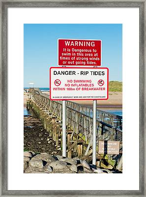 Tide Warning Framed Print by Tom Gowanlock