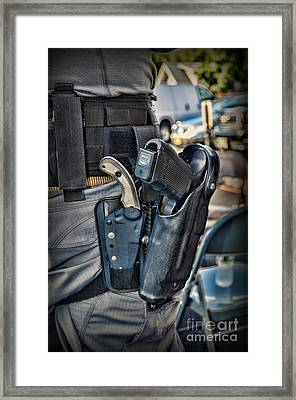 To Protect And Serve Framed Print by Paul Ward