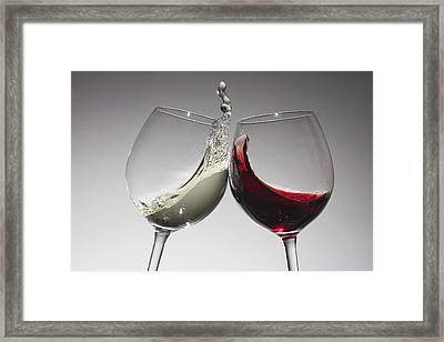 Toasting With Glasses Of Water And Red Wine Framed Print by Dual Dual