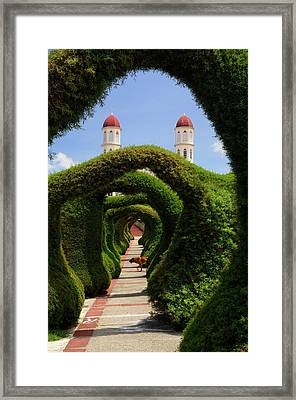 Topiary Garden Archways In Zarcero Costa Rica With Church And Do Framed Print by Reimar Gaertner