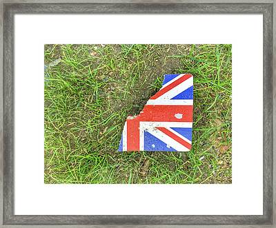 Torn Card On Grass Framed Print by Tom Gowanlock