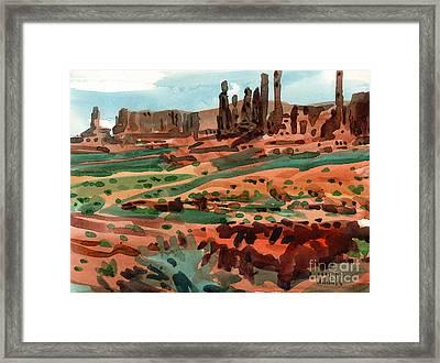 Totem Poles Framed Print by Donald Maier