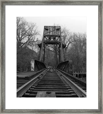 Tracking The Past Framed Print by Kelvin Booker