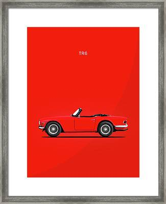 Triumph Tr6 In Red Framed Print by Mark Rogan