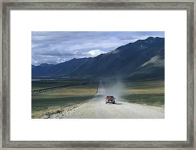 Truck On The Dalton Highway Following Framed Print by Rich Reid