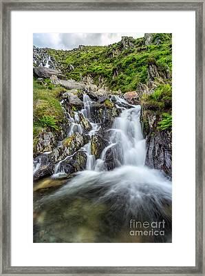 Tryfan Mountain Rapids Framed Print by Adrian Evans