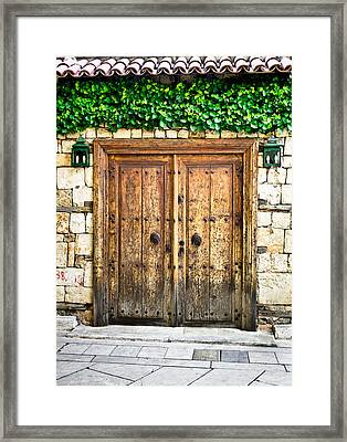 Turkish Door Framed Print by Tom Gowanlock
