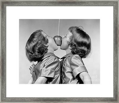 Twin Girls Bobbing For Apple Framed Print by H. Armstrong Roberts/ClassicStock
