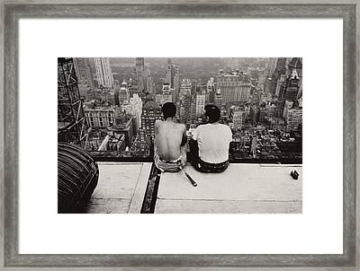 Two Men Sitting On A Scaffold Overlooking Manhattan Framed Print by Nat Herz