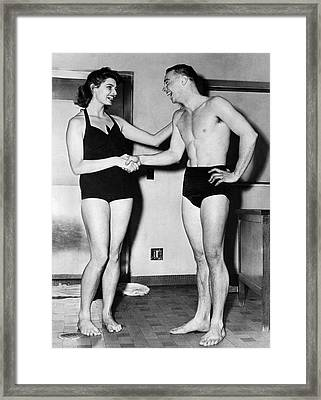 Two Swimming Stars Framed Print by Underwood Archives