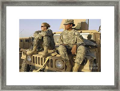 Two U.s. Army Soldiers Relax Prior Framed Print by Stocktrek Images