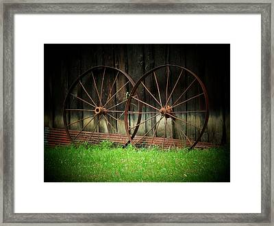 Two Wagon Wheels Framed Print by Michael L Kimble