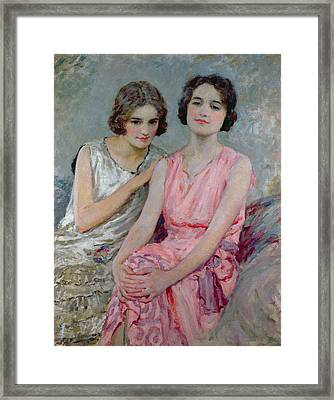 Two Young Women Seated Framed Print by William Henry Margetson