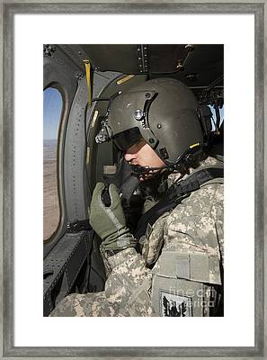 Uh-60 Black Hawk Crew Chief Looking Framed Print by Terry Moore