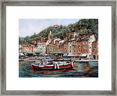 Una Lunga Barca Rossa Framed Print by Guido Borelli