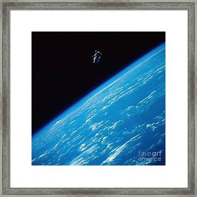 Unattached Space Walk Framed Print by Stocktrek Images