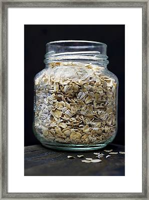 Uncooked Oatmeal Flakes Framed Print by Donald  Erickson