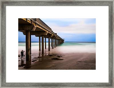 Under The Pier Framed Print by Larry Marshall