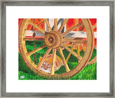 Under The Wagon Framed Print by David Bigelow