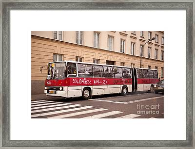 Unique Solidarnosc Bus On Street Framed Print by Arletta Cwalina