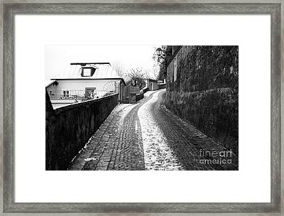 Up The Road In Salzburg Framed Print by John Rizzuto