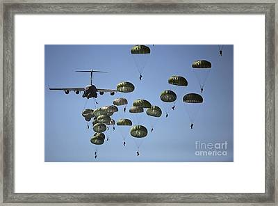 U.s. Army Paratroopers Jumping Framed Print by Stocktrek Images