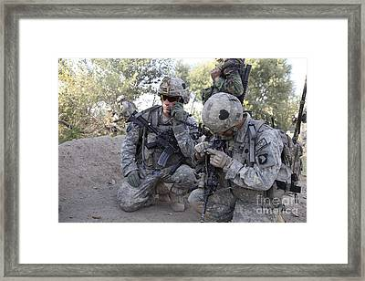 U.s. Army Soldier Radios In His Teams Framed Print by Stocktrek Images