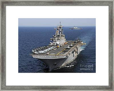 Uss Essex Transits Off The Coast Framed Print by Stocktrek Images