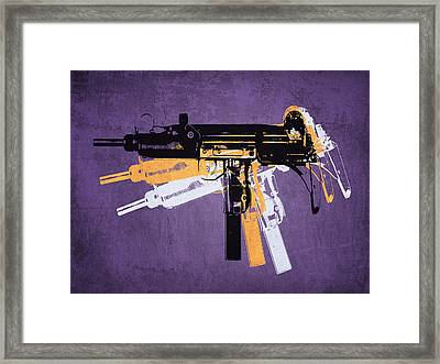Uzi Sub Machine Gun On Purple Framed Print by Michael Tompsett