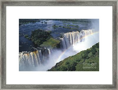 Victoria Falls Rainbow Framed Print by Sandra Bronstein