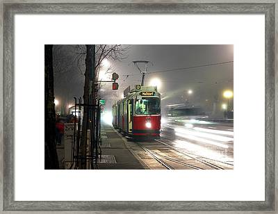 Vienna Tram At Night Framed Print by John Rizzuto