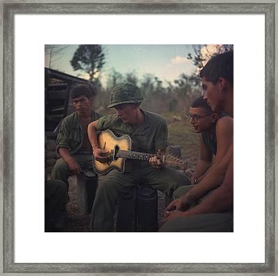 Vietnam War. Us Army Infantrymen Gather Framed Print by Everett