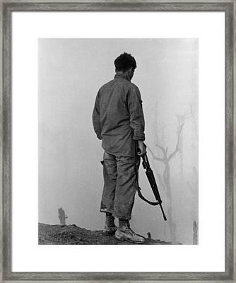 Vietnam War. Us Infantryman Looks Framed Print by Everett