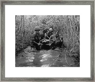 Vietnam War. Us Soldiers Carry Framed Print by Everett