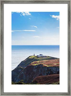 View Of The Trails On Howth Cliffs With The Lighthouse In Irelan Framed Print by Semmick Photo
