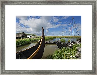 Viking Boats Framed Print by Robert Lacy