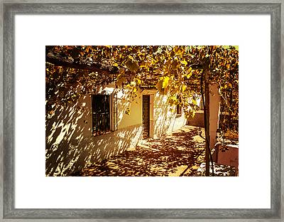 Vine-covered Patio. Andalusia. Spain Framed Print by Jenny Rainbow