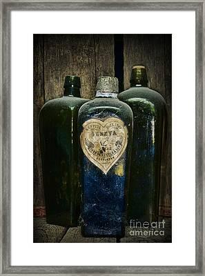 Vintage Case Gin Bottles Framed Print by Paul Ward