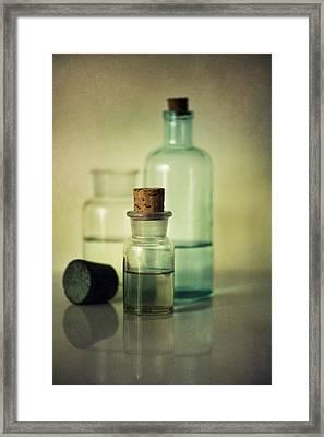 Vintage Medical Bottles Framed Print by Jaroslaw Blaminsky