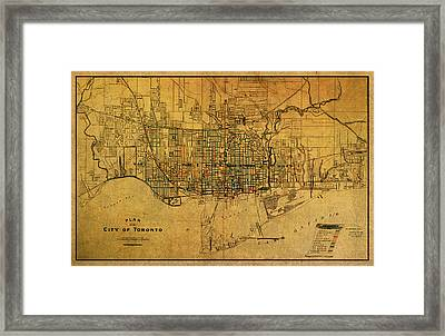 Vintage Street Map Of Toronto Canada Circa 1907 On Worn Distressed Parchment Framed Print by Design Turnpike