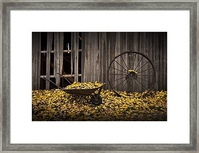 Wagon Wheel Rim And Wheel Barrel Covered With Fallen Autumn Leaves Framed Print by Randall Nyhof