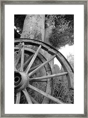 Wagon Wheels Framed Print by Robert Lacy