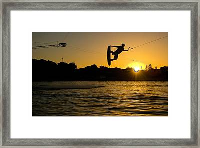 Wakeboarder At Sunset Framed Print by Andreas Mohaupt