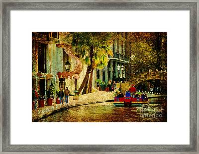 Walking Along The Riverwalk Framed Print by Iris Greenwell