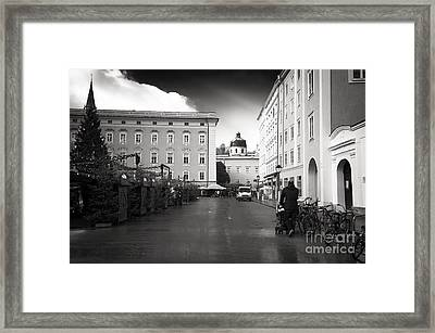 Walking The Baby In Salzburg Framed Print by John Rizzuto