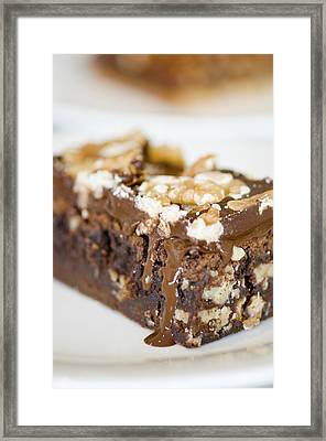 Walnut Brownie On A White Plate Framed Print by Ulrich Schade