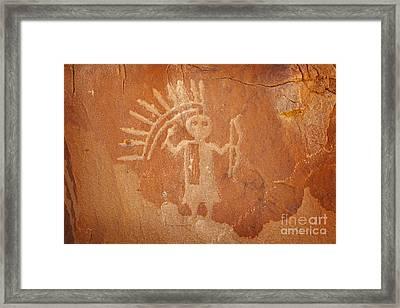 Native American Warrior Petroglyph On Orange Sandstone Framed Print by John Stephens