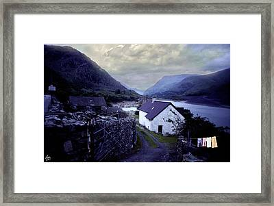 Washday At The White Cottage Framed Print by Wayne King
